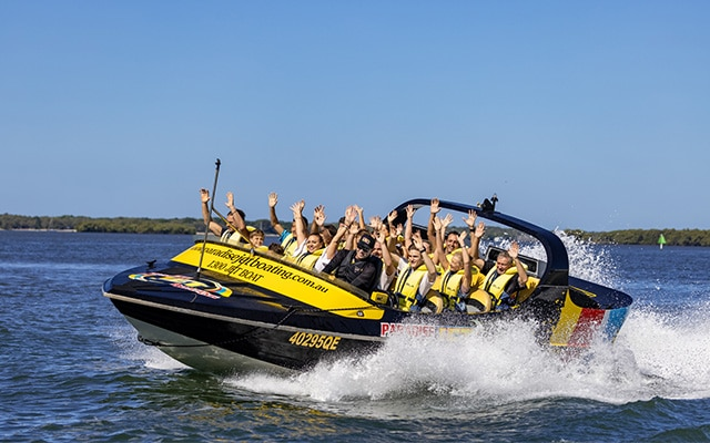 Paradise-Jet-Boating-Broadwater-Hands-in-Air-action-shot