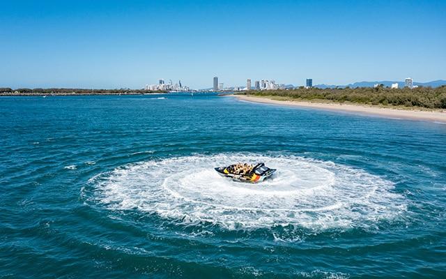 Paradise-Jet-Boating-Wave-Break-Island-Aerial-360-spin-Action-Surfers-Paradise-backdrop