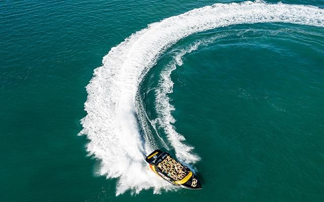 Paradise-Jet-Boating-Wave-Break-Island-Aerial-anticlockwise