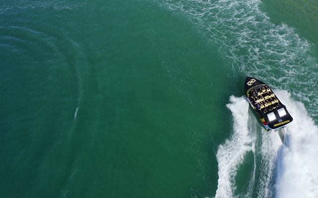 Paradise-Jet-Boating-Wave-Break-Island-aerial-image